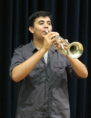 student playing the trumpet