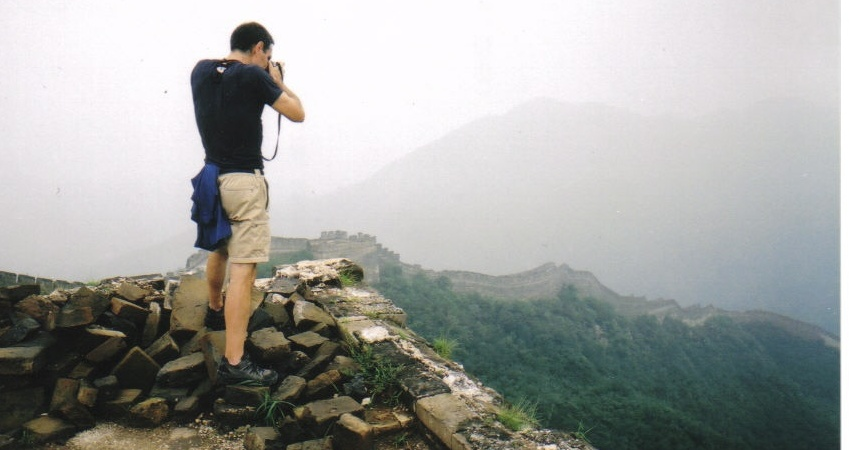 Reed photographing an Eastern section of the Great Wall (photo by  Ty Buckman)