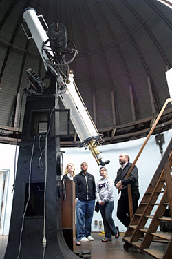 Dr. Fleisch with telescope in Weaver Observatory