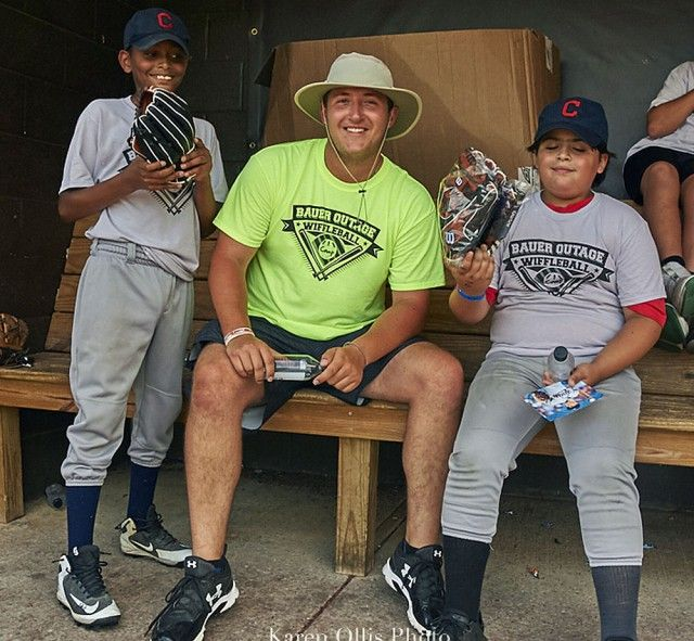 Jack Hollinshead with young baseball players