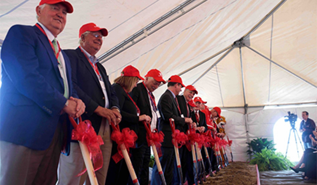 Shovels in hand at groundbreaking ceremony
