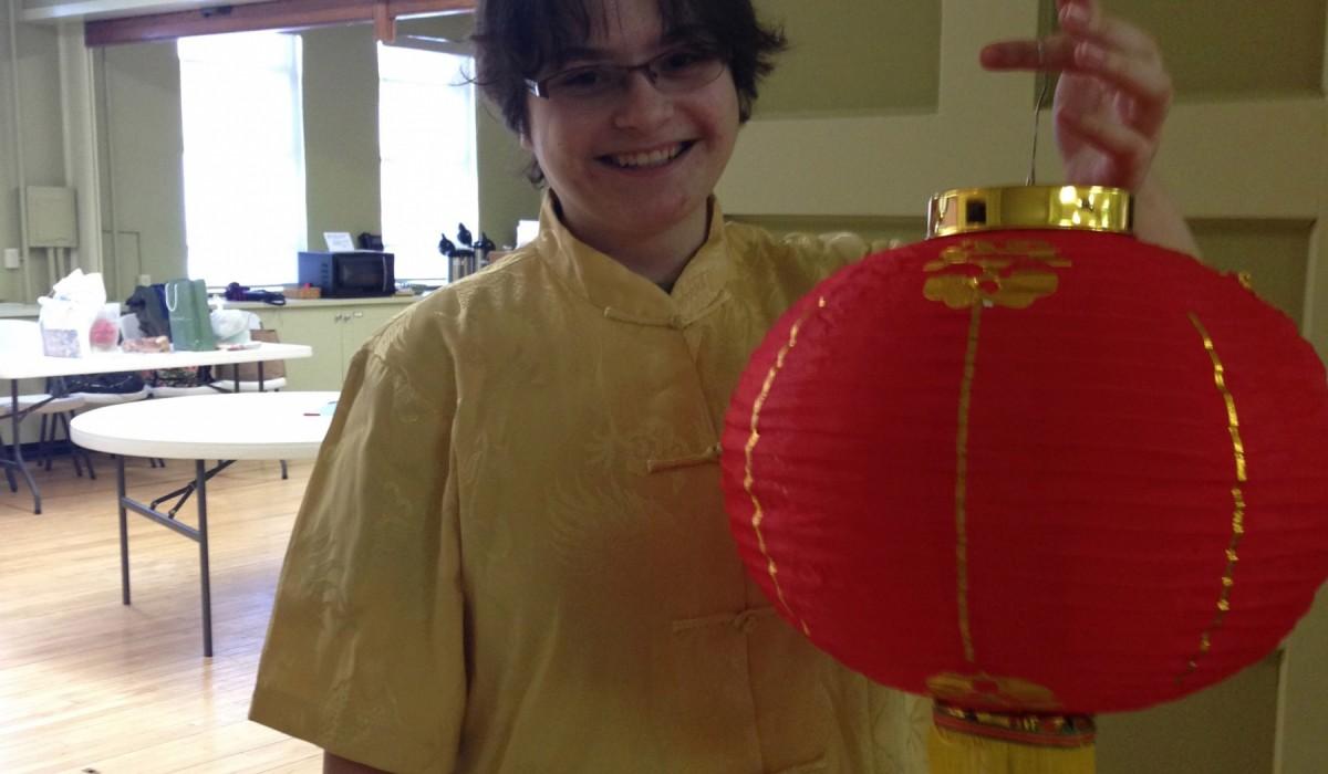 Emmaline Higgins '18 holding a Chinese Lantern