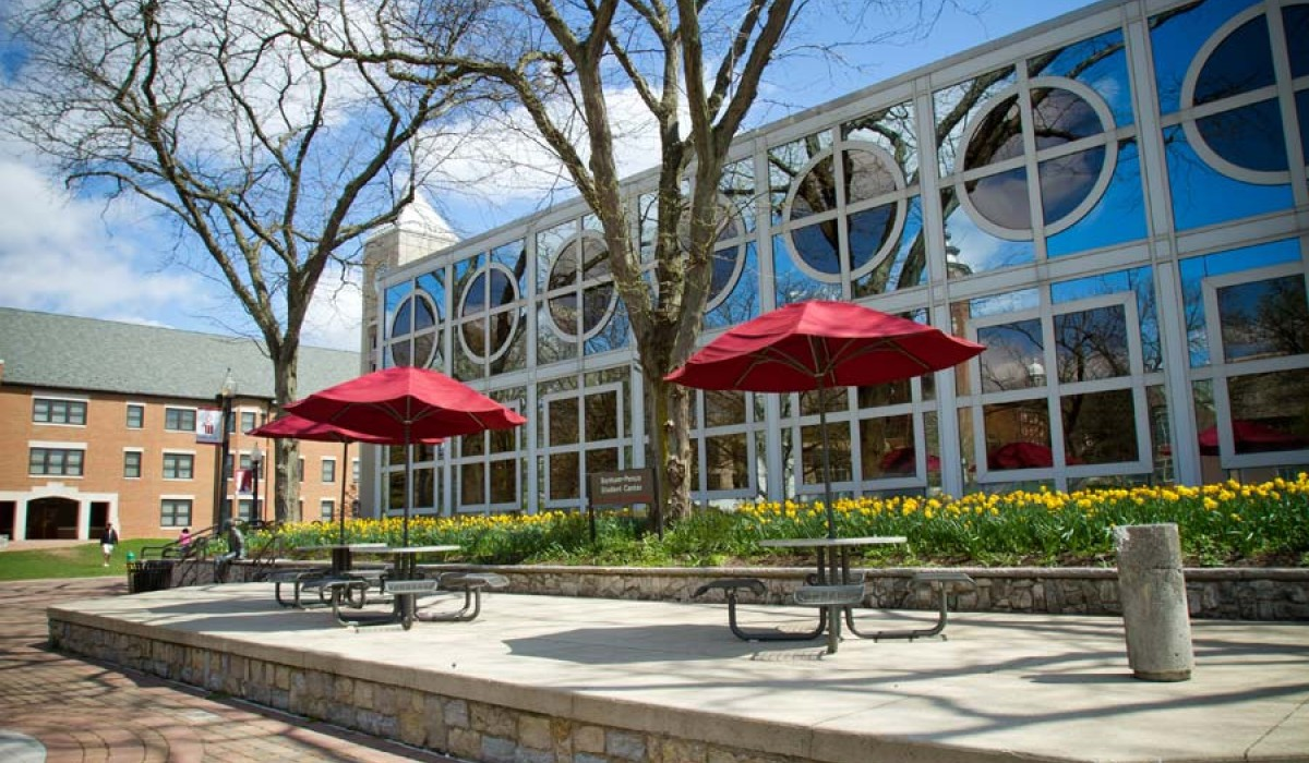Student Center patio tables on Alumni Way