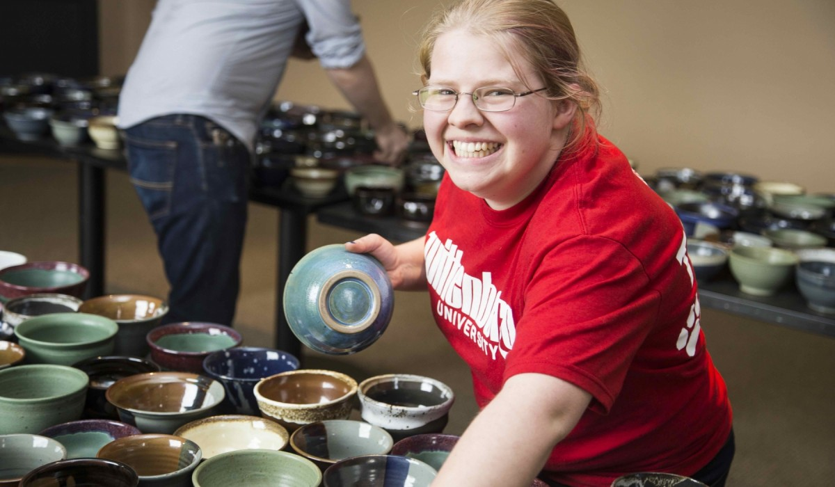 Student at Empty Bowls event