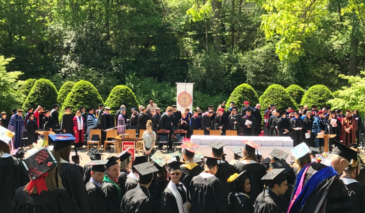Students in caps and gowns after the ceremony