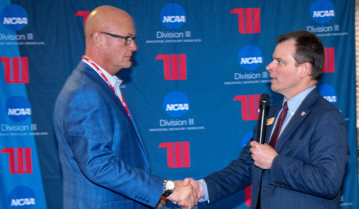 Tim Kremchek '81 and University President Mike Frandsen