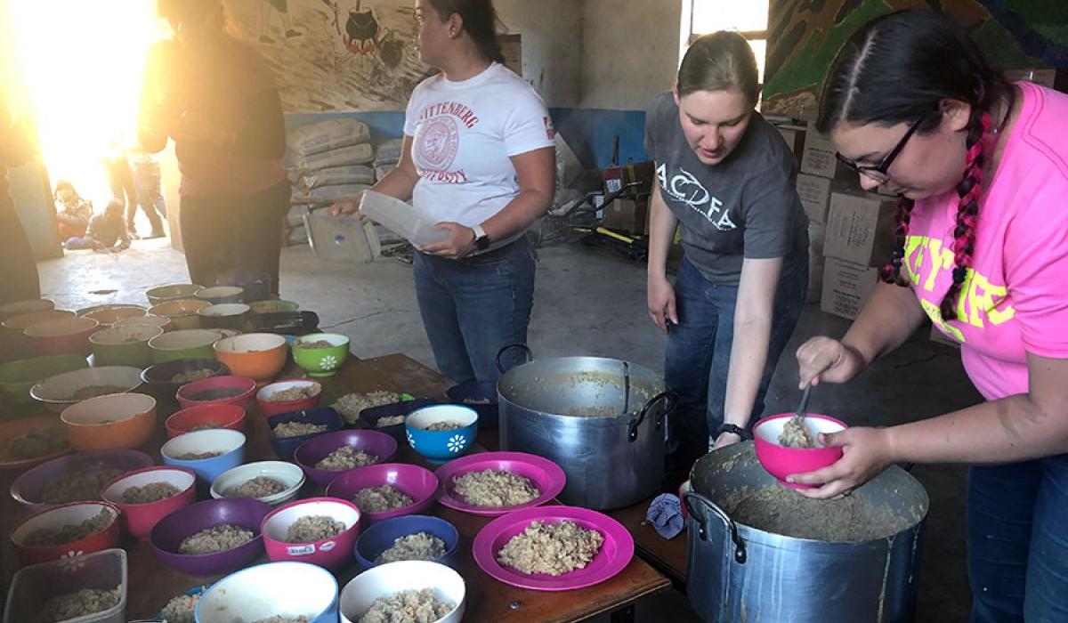 Destiny and Rebecca serving LNI meals