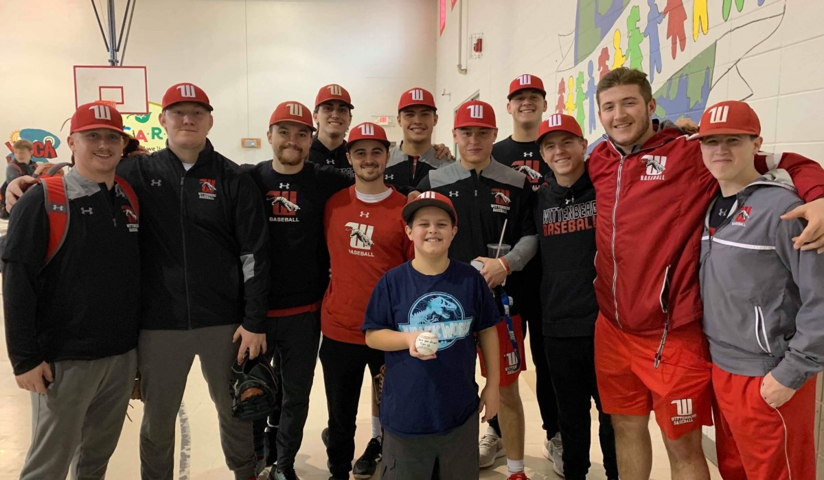 Wittenberg baseball working with children at the Springfield YMCA