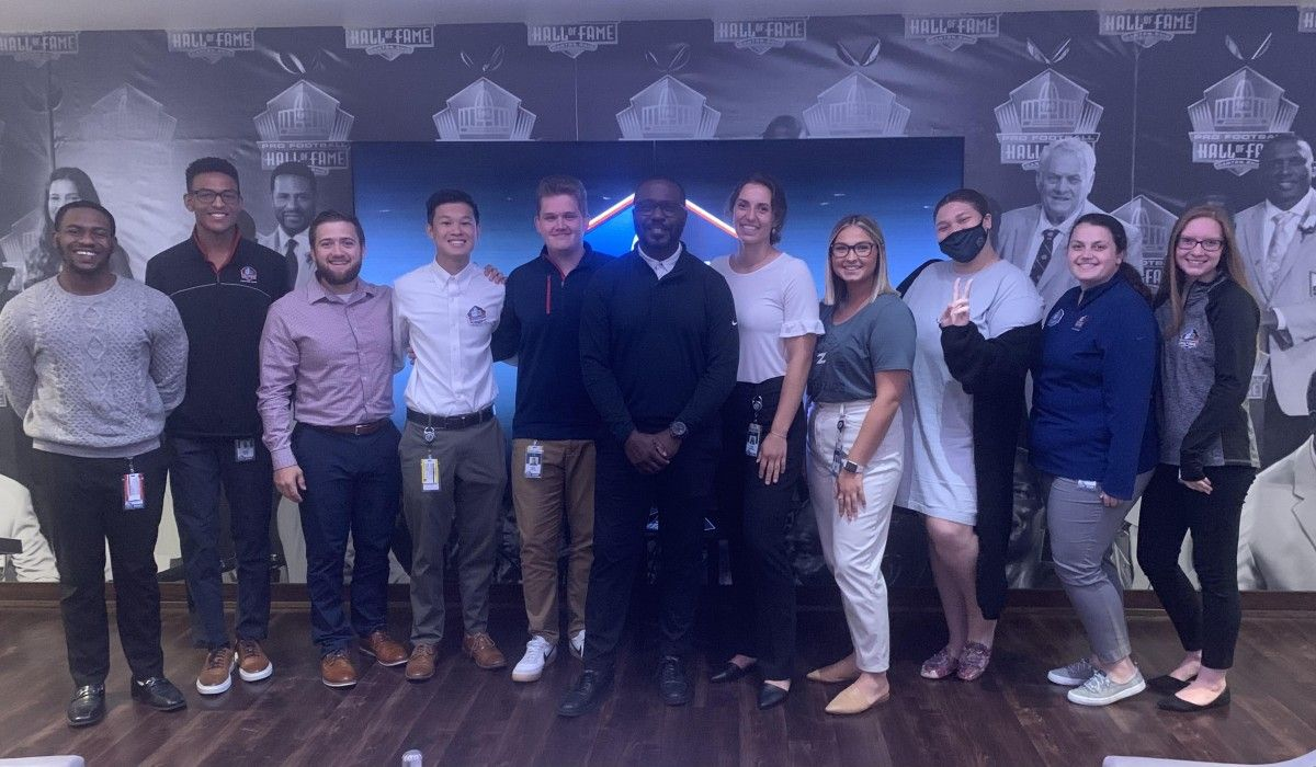 Katie Hiestand '22 (5th from right) with Hall of Famer Marshall Faulk